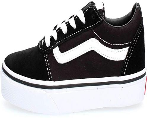 A Pair Of Vans Sneakers